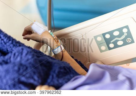 Old Woman Patients Hand Have A Blood Transfusion In The Hospital.