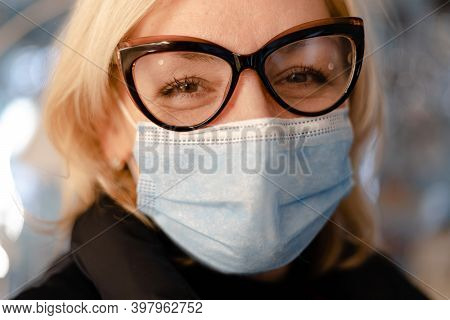 Middle Aged Woman With Protective Face Mask And Glasses Close Up Portrait