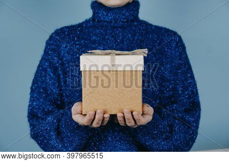 Merry Christmas Card, Hew Year, Xmas, Birthday Banner. Female Hands In Blue Sweater Holding Craft Gi