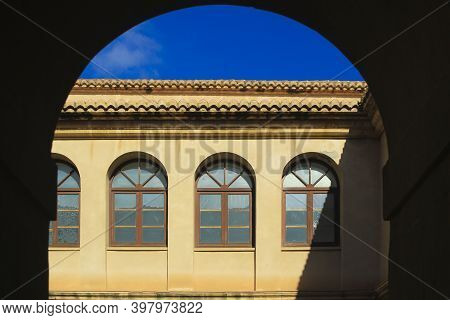 Elche, Alicante, Spain- November 30, 2020: Beautiful Arches And Windows Of The Cloister Of The Conve