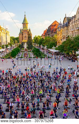 Timisoara, Banat, Romania - June 06, 2015: View From Above On Group Of People Who Works Out On Exerc