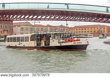 Vence, Italy - February 3, 2018: Public Transport Boat Under Footbridge At Cold Winter Day In Vence,