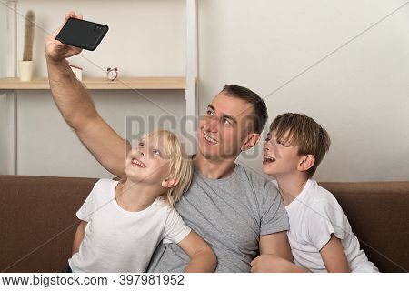 Young Father And His Sons Photographed Themselves In New Home.