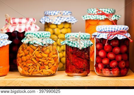 Assorted homemade vegetables preservation in glass jars. Preserved food in glass jars. Homemade pres