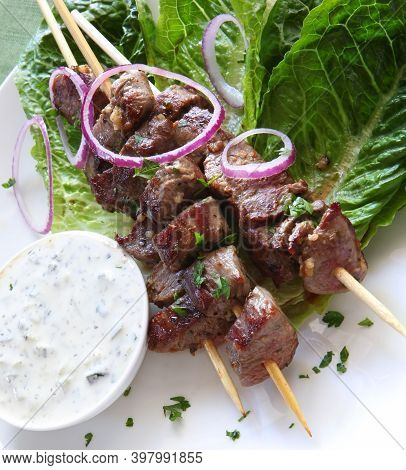 Delicious Meat Satay With Vegetables On A White Plate