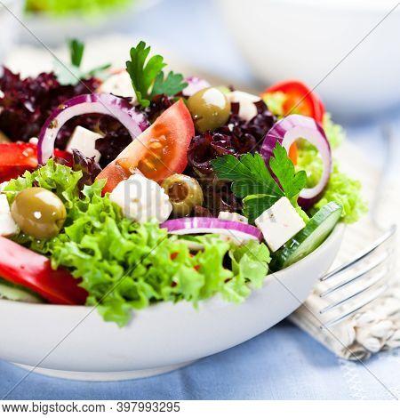 Vegetable Salad On A White Plate. Healthy Food Vegetable Salad