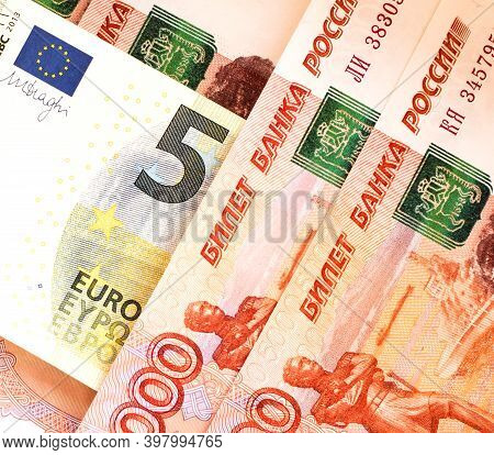 Banknote 5 Euro On The Background Of Banknotes 5000 Rubles Close-up. Ruble Devaluation Concept. Sanc