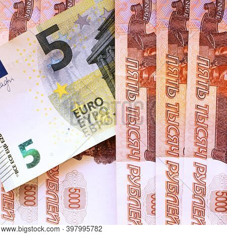 5 Euro Banknote And 5000 Russian Ruble Banknotes. Exchange Rate. Ruble Devaluation Concept. Money Ba