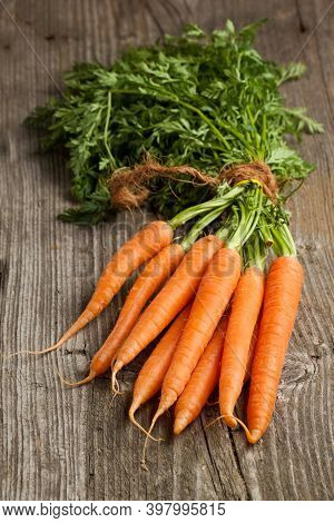 Fresh Carrots Bunch On Rustic Background. Healthy Vegan Vegetable Food.carrots. Fresh Carrots Bunch