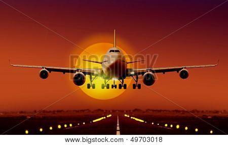 Airplane Landing during sunset