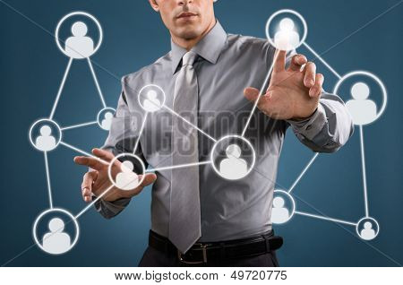 Modern businessman touch a digital screen for business social networking poster