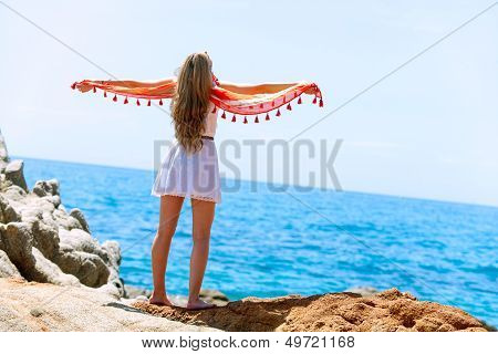 Woman With Colorful Shawl At Seashore.