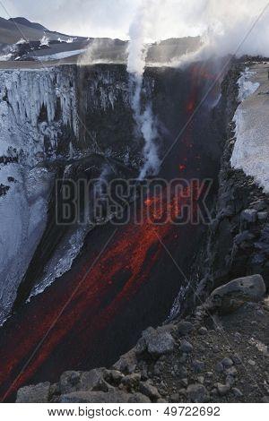 Molten lava and smoke of Eyjafjallajokull Fimmvorduhals Iceland