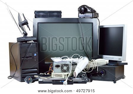 poster of Old and used electric home waste. Obsolete pc computer telephone CRT monitor DVD.