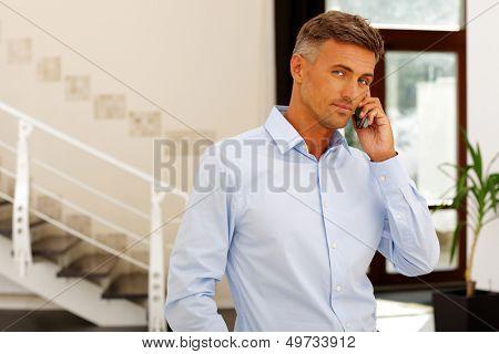 Mature happy caucasian man on phone