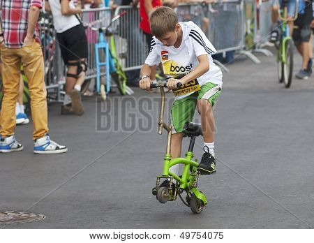 MOSCOW - JULY 13: Unidentified Kid on strange bicycle on city event Sport of Moscow passing in Luzhniki on July 13 2013 in Moscow Russia poster