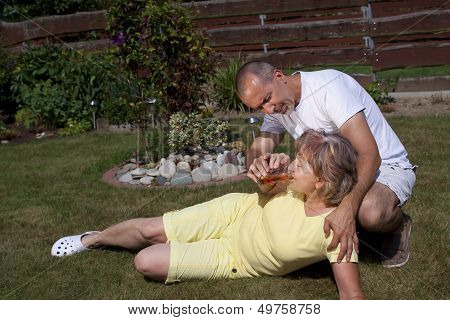 Man Gives Woman With Heat Exhaustion Something To Drink