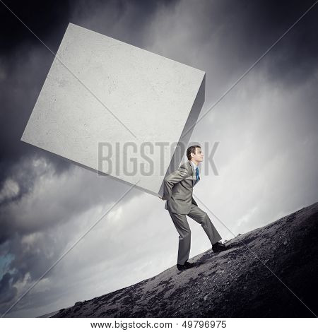 poster of Image of businessman carrying big white cube on his back