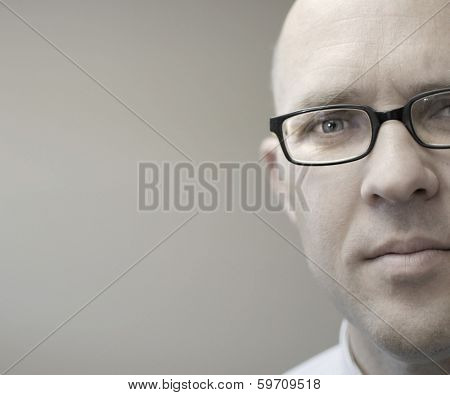 Businessman in business office looking at viewer