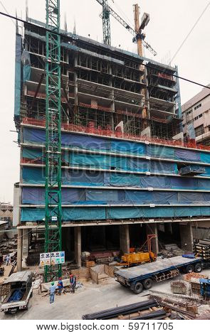 BANGKOK, THAILAND - JANUARY 11, 2012: Workers on  construction site. Bangkok is on of the world's fastest growing megacities.