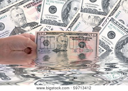 hand holding a dollar bill, business studio photo