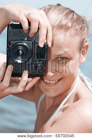 Woman laughing as she views a photo