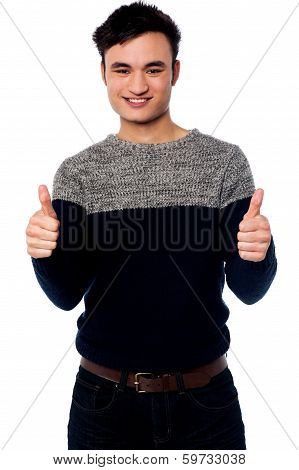 Young Casual Guy Gesturing Double Thumbs Up