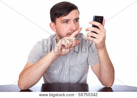 man pointing at smartphone screen on white background