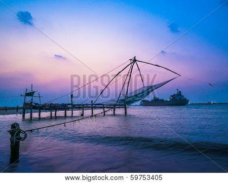 Kochi Chinese Fishnets And Vessel On Sunset  In Kerala. Fort Kochin, Kochi,  South India