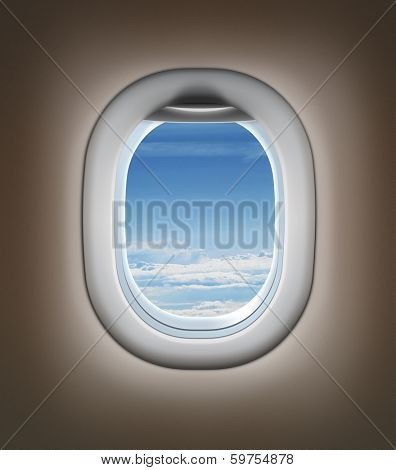Travel by airplane concept. Airplane interior or jet window with clouds and sky.