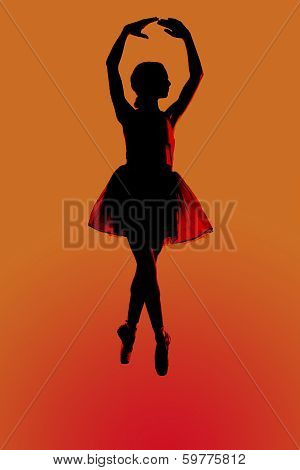 Silhouettr Of A Young Balerina With An Orange Background