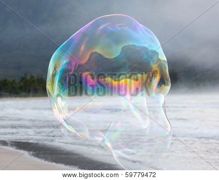 Man Making Large Soap Bubbles On Beach