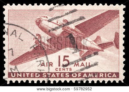 USA-CIRCA 1941: A 15 cent United States Airmail postage stamp shows image of a twin-engined transport plane, circa 1941.