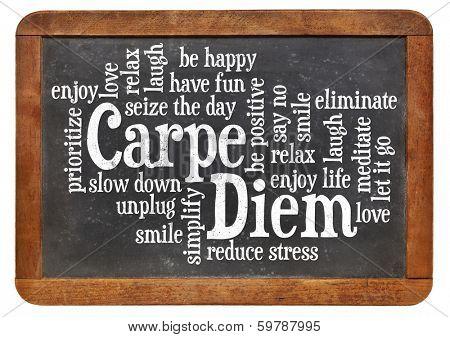 Carpe DIem word cloud on a vintage slate blackboard isolated on white