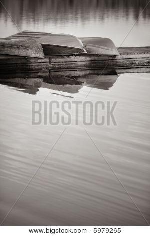 Row Boats On Lake Dock Reflections Trees