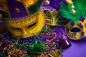 Festive Grouping of mardi gras, venetian or carnivale mask on a purple background poster