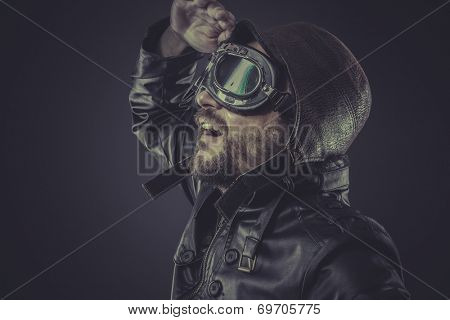 fun, pilot dressed in vintage style leather cap and goggles poster