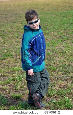 Boy In Windbreakers And Sunglasses