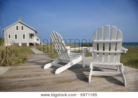 Chairs On Deck Facing Ocean