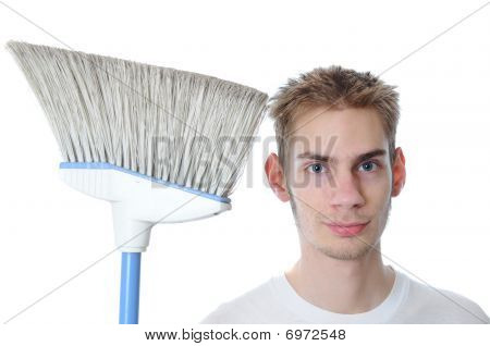 Young Janitor Smiling With Broom