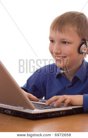 Boy In The Blue Shirt Looks Into The Laptop