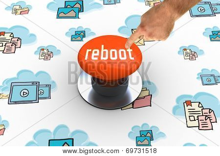 The word reboot and hand pointing against orange push button