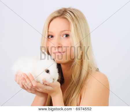 Young girl holding a white little rabbit poster