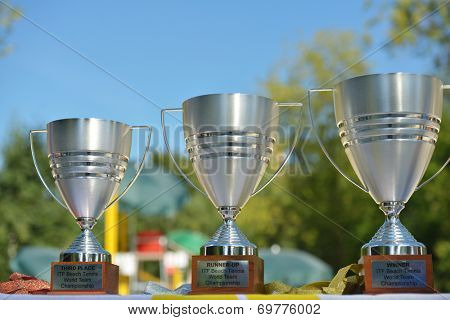 MOSCOW, RUSSIA - JULY 20, 2014: Trophies of the ITF Beach Tennis World Team Championship. Italy became winner, Brazil is runner-up, and Russia took the third place