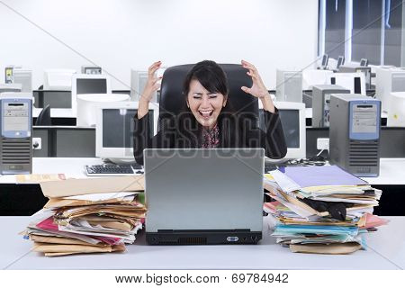 Stressfull Businesswoman Screaming In Office