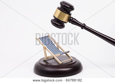 Wooden gavel and deck chair