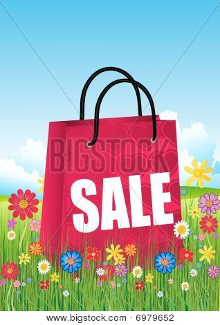 Red shopping bags with spring flowers and grass