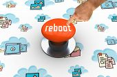 The word reboot and hand pointing against orange push button poster