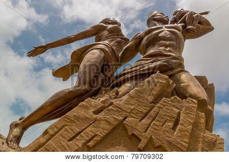 Dakar Senegal - July 10: The African Renaissance Monument is a 49 meter tall bronze statue of a man woman and child. July 10, 2014 Dakar, Senegal