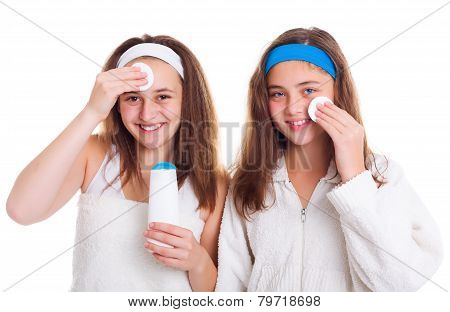 Girls Cleaning Theirs Face With Tonic Lotion